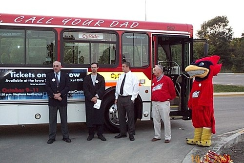 957 with staff and mascot